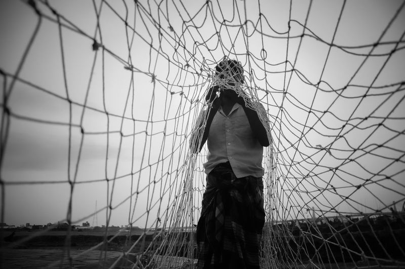 Fisherman repairing his fishing net . Fisherman Fishingnet People Net Traveling Bangladesh Lifestyles Eyeemmarket Eyeem On Week Travel Photography The Global EyeEm Adventure