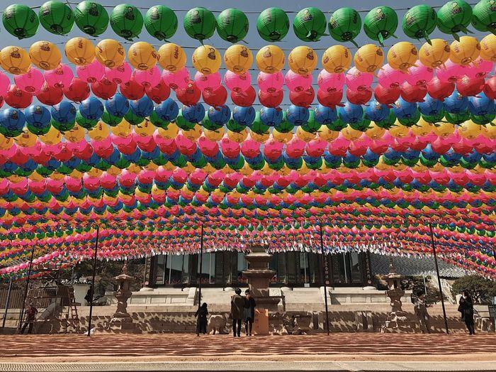 People on multi colored umbrellas