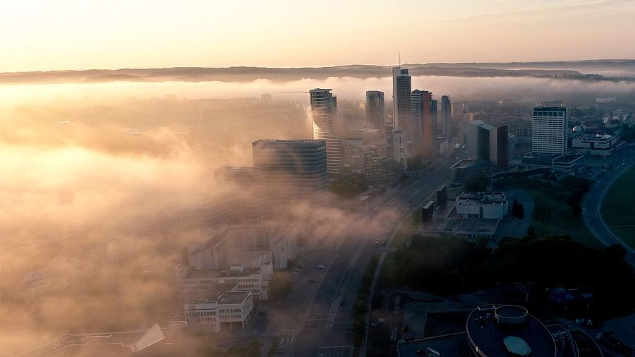 Misty Morning Downtown Capital Vilnius Lithuania Lietuva Downtown Mist Fog Financial District  Financial District Centre Center Panoramic Aerial Drone  City Cityscape Urban Skyline Skyscraper Sunset Fog Aerial View Sky Architecture Office Building Air Pollution Smog Sun Sunbeam Calm