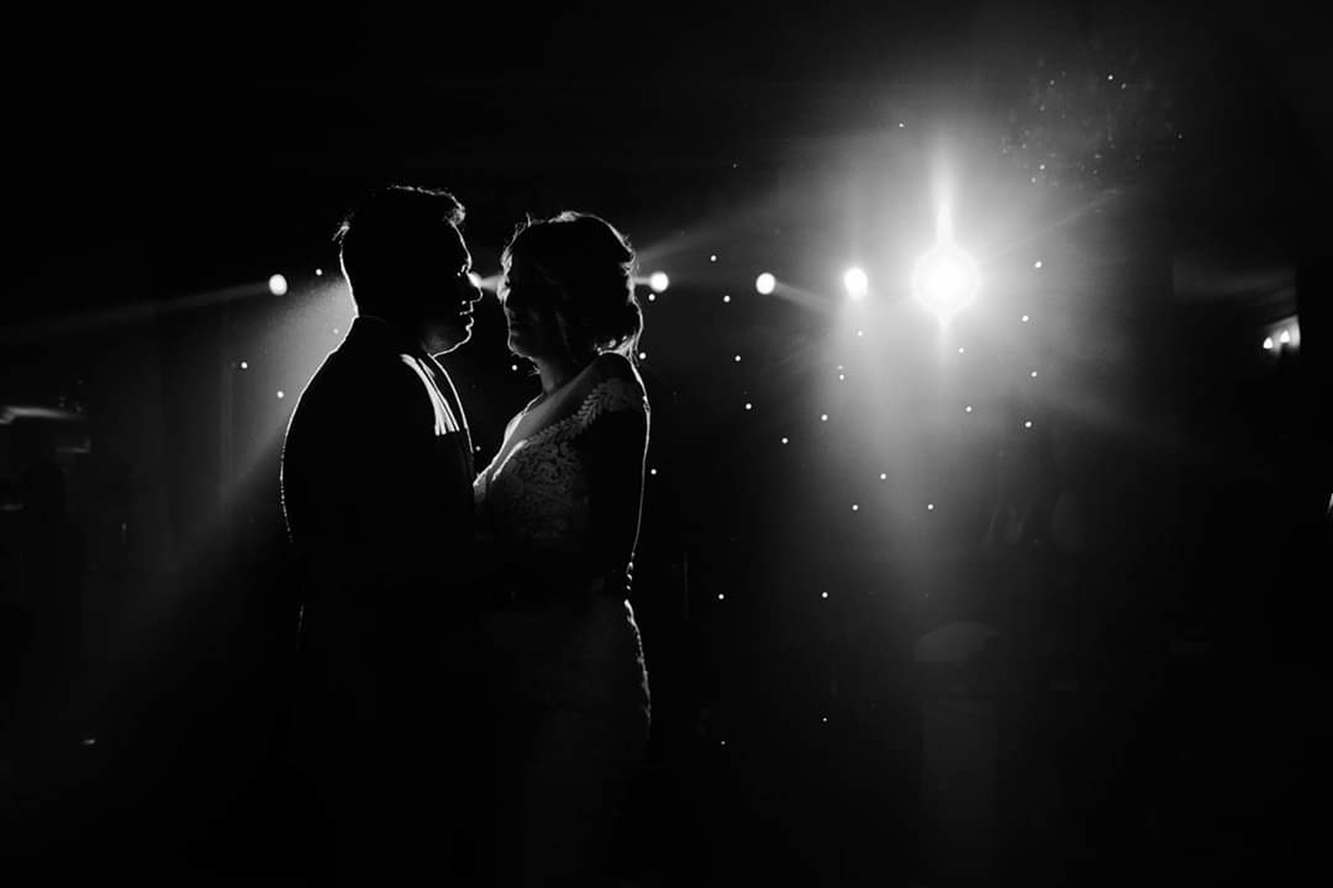two people, night, togetherness, illuminated, love, couple - relationship, positive emotion, emotion, adult, men, indoors, heterosexual couple, arts culture and entertainment, people, silhouette, nightlife, standing, back lit, event, women, stage