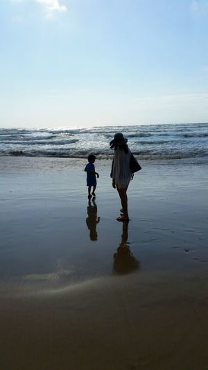 Reflection Full Length Two People Water Walking Care Nature Environment Adults Only Adult Real People Outdoors Sky People Beauty In Nature Day Bonding Men Baby Stroller Togetherness This Is Family