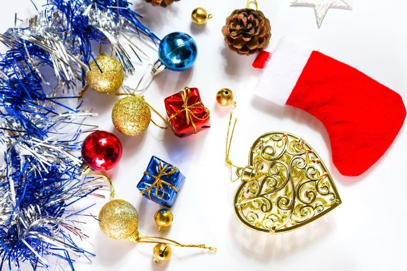 High angle view of christmas decorations on white background