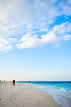 sunset at Gili Meno Island Beach Sand Sea Sky Horizon Over Water Water Full Length Cloud - Sky People Wave Day Water's Edge Summer Vacations Two People Travel Destinations Adult Blue Nature Outdoors EyeEmNewHere