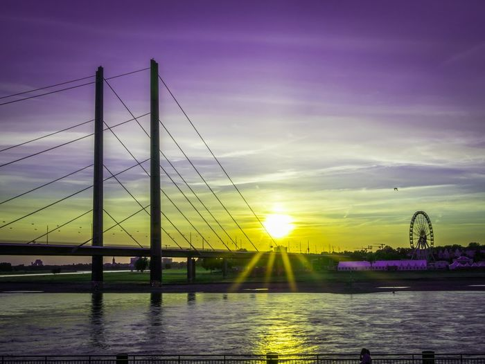 summertime Sunshine Sunlight Sunset_collection Water City Illuminated Sunset Multi Colored Bridge - Man Made Structure Purple River Suspension Bridge Sky Cable-stayed Bridge The Traveler - 2018 EyeEm Awards