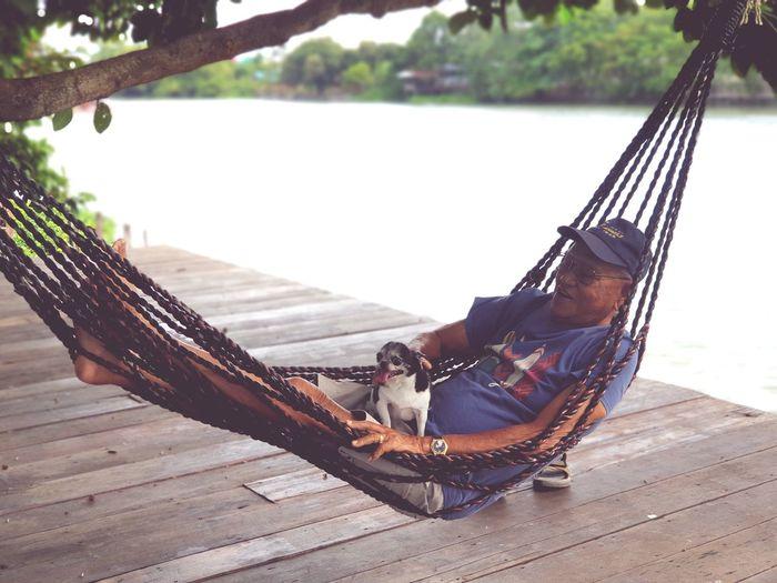 Young woman sitting on hammock