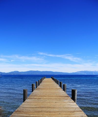 Enjoyable Jetty to the lake California Squaw Valley Beauty In Nature Blue Blue Sky Clouds Day Fengshui  Jetty Lake Tahoe Lake Tahoe Water Sports Mountains And Sky Nature Nevada No People Outdoors Pier Scenics Sea Sky Tranquil Scene Tranquility Water Wood - Material Wood Paneling