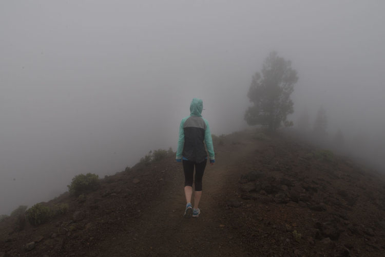 Alone Fear Hiking Misty Rear View Adventure Beauty In Nature Cold Temperature Fog One Person Outdoors Scenics - Nature Thriller Trail