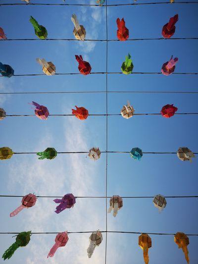 Full frame shot of multi colored umbrellas against blue sky