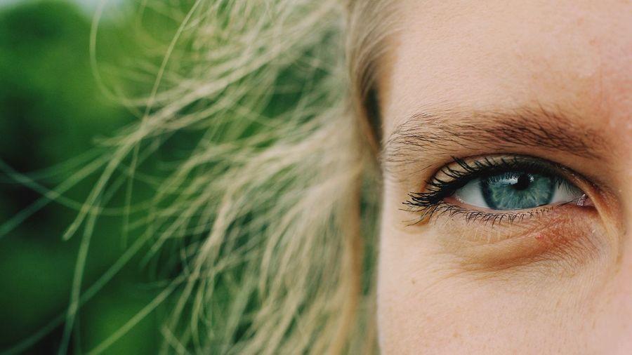 Close-up portrait of woman gray eye