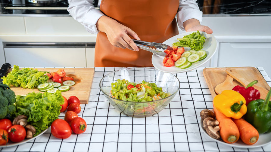 Midsection of man preparing fruits on cutting board