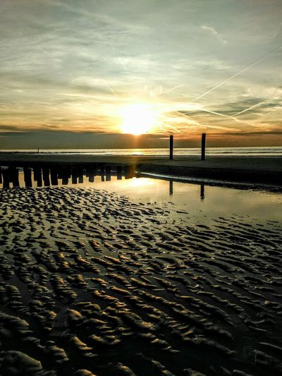 Sunset Water Sea Beach Beauty In Nature Reflection Sky Outdoors Nature Tranquil Scene Silhouette Scenics Sand Tranquility No People Rural Scene Horizon Over Water Day Northsea Zeeland  Travel Travel Photography Netherlands Idyllic Westkapelle Welcome To Black