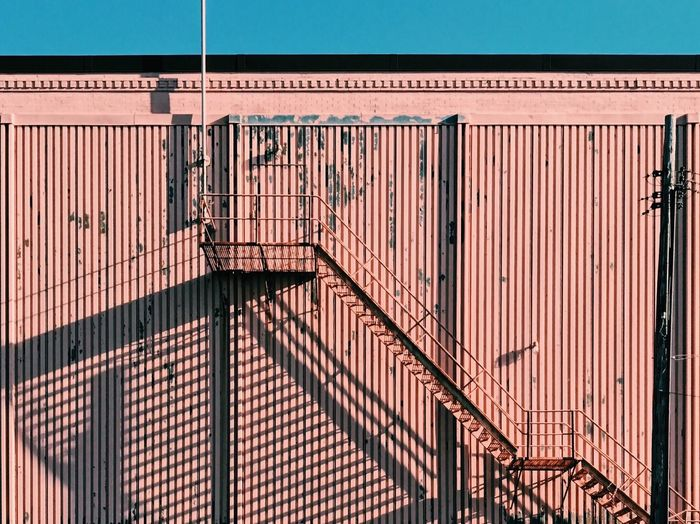 The Afternoon. Day No People Backgrounds Shadow Shadows Stairs Pink Wall Lines Architecture_collection Built Structure Building Exterior Pattern Striped Textured  Façade Architecture Building Metal Railing Industry Wall - Building Feature Security Protection Safety Fire Escape
