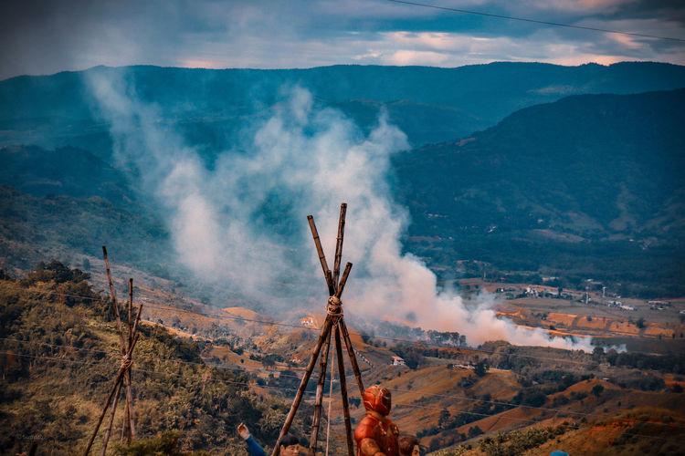 Panoramic view of smoke emitting from volcanic mountain