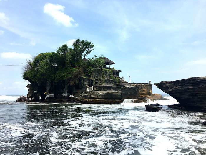Sea Temple Architecture Temple - Building Temple Tanah Lot Temple Tanah Lot Green Color Bali, Indonesia Sky Tree Plant Cloud - Sky Water Nature Day Sea Beauty In Nature Land Tranquility Outdoors Sunlight Beach Scenics - Nature Tranquil Scene Growth Sunny
