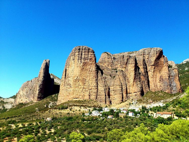 Miles Away Tourism Outdoors Mountain Travel Sky Conglomerate Rocks Rock Climbing Climbers Formations Vertical Town Climb Riglos Pyrenees Huesca