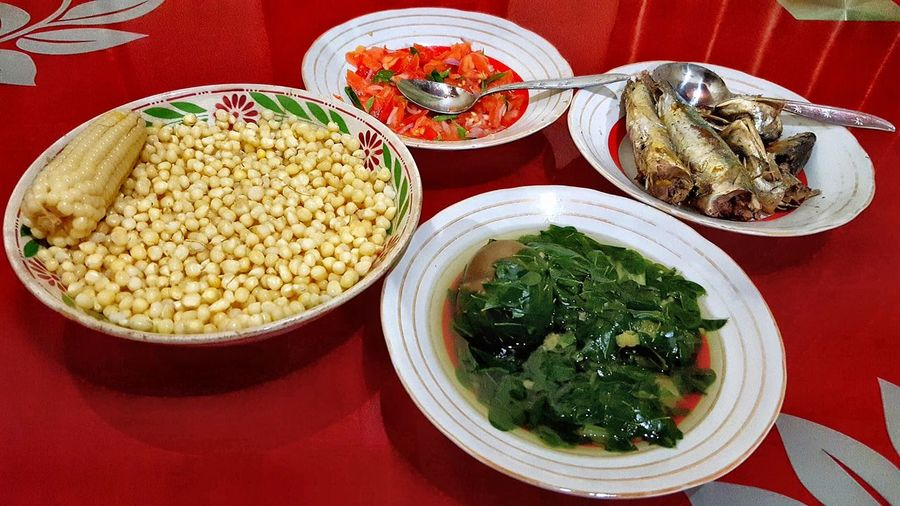 traditional food Foodphotography food stories Corn Cornkernels Vegetable Vegetable Soup Fish Fishcook Red Plate Bowl Table Close-up Food And Drink Prepared Food Corn On The Cob Sweetcorn Corn - Crop