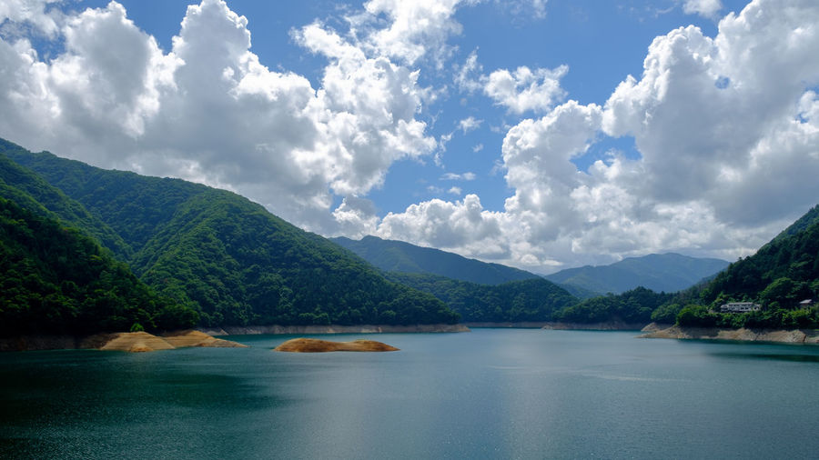 Okutama Dam Lake Tokyo Japan. Beauty In Nature Blue Calm Cloud Cloud - Sky Cloudy Day Idyllic Lake Landscape Majestic Mountain Mountain Range Nature No People Non Urban Scene Non-urban Scene Outdoors Remote Scenics Sky Tranquil Scene Tranquility Tree Water