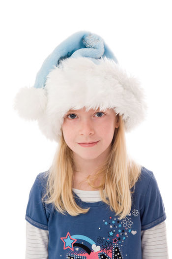 Portrait of girl wearing hat against white background