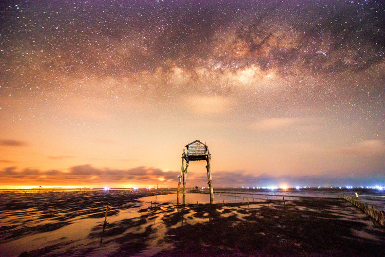 Colorful Milky Way Galaxy in the night sky Sky Built Structure Architecture Scenics - Nature Night Star - Space Beauty In Nature Water Nature Astronomy Cloud - Sky Tower Sea Land Building Exterior Sunset Space No People Beach Outdoors Milky Way Nightphotography Non-urban Scene Rural Scene Star Galaxy Night Sky