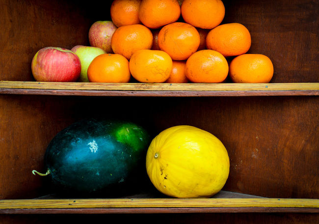 Fruits On A Shelf Market Stall Fruit Stall Fruit Freshness Healthy Lifestyle Healthy Eating Food No People Indoors  Day Abundance Still Life Arrangement Pattern, Texture, Shape And Form Abstract Copy Space Arranged Objects Fruitful Shadow And Light Shadows And Light Apple - Fruit Orange - Fruit Pomegranate