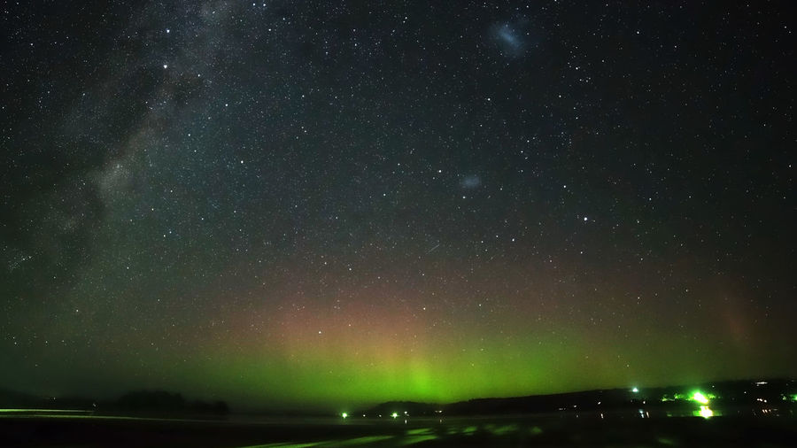 Aurora Australis rays and Milky Way Geomagnetic Disturbance Astronomy Beauty In Nature Galaxy Geomagnetic Storm Green Color Idyllic Illuminated Low Angle View Majestic Milky Way Nature Night No People Outdoors Scenics - Nature Sky Solar Storm Southern Lights Space Star Star - Space Star Field Tranquil Scene Tranquility