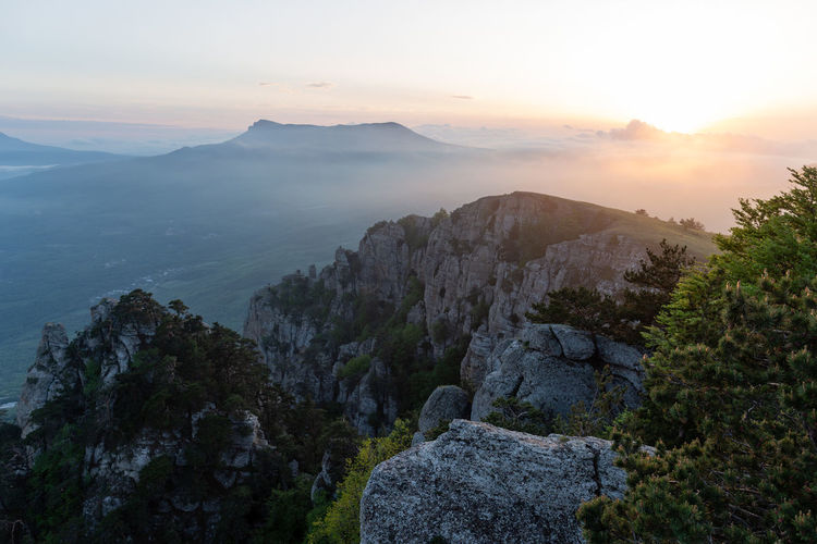 Sky Beauty In Nature Scenics - Nature Mountain Tranquility Tranquil Scene Sunset Rock Nature Non-urban Scene Idyllic Rock - Object Environment Solid Landscape No People Cloud - Sky Mountain Range Sun Remote Outdoors Formation