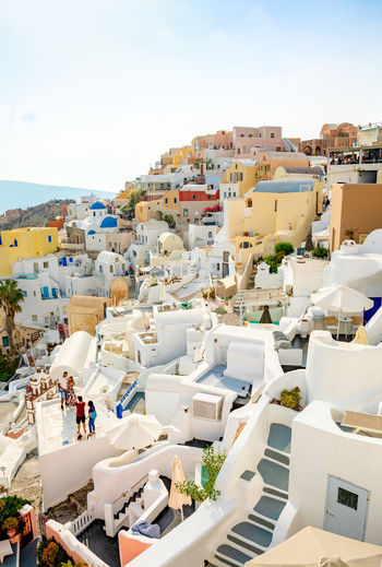 Greece Santorini Oia Thira Building Exterior Architecture Sky Built Structure Group Of People City Crowd High Angle View Day Building Residential District Nature People Real People Incidental People Men Outdoors Clear Sky Town Cityscape