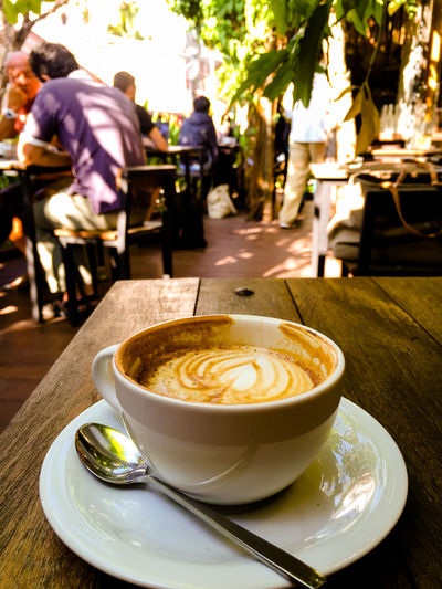 Coffee served on table at cafe