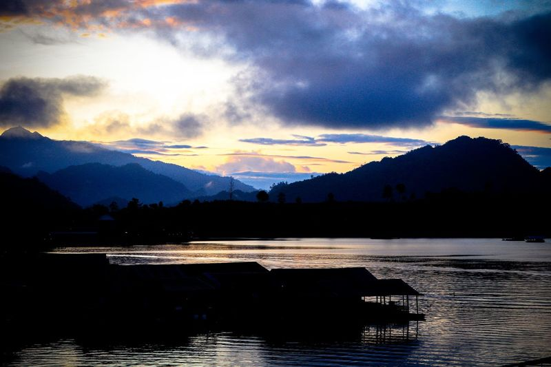Beauty In Nature Cloud - Sky Day Idyllic Lake Mountain Mountain Range Nature No People Outdoors Range Reflection Scenics Silhouette Sky Sunlight Sunset Tranquil Scene Tranquility Tree Water Waterfront