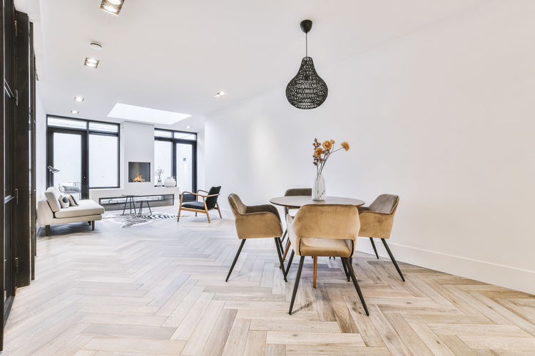 Empty chairs and tables against wall at home