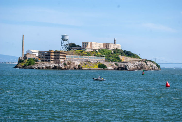 Alcatraz Alcatraz Island Water Sea Waterfront Architecture Sky Nature Building Exterior Built Structure Nautical Vessel Day Beauty In Nature Transportation Real People Scenics - Nature Blue Mode Of Transportation Building Travel Destinations Land Outdoors