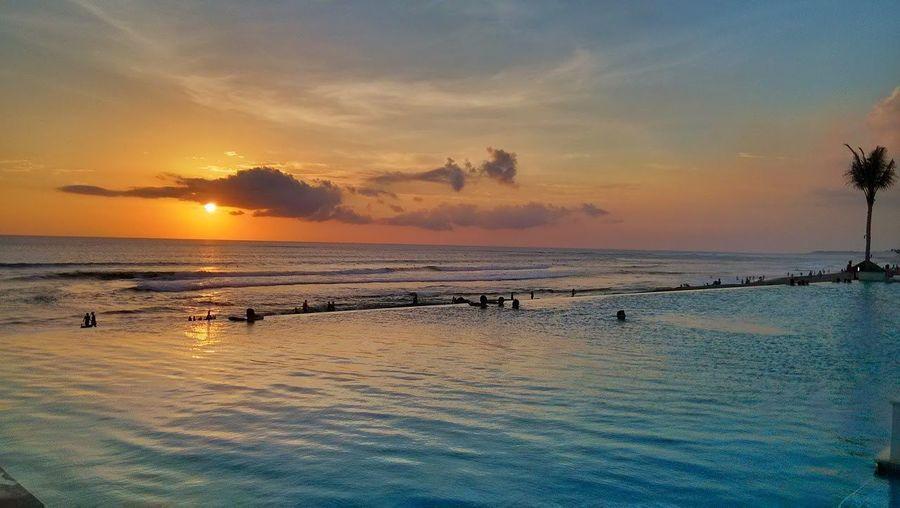 Smartphone Xiaomi Mi2, Sunset Bali Indonesia Sunset Sea Cloud - Sky Outdoors Nature Scenics Beauty In Nature Sky Water Dramatic Sky Beach Sun Vacations Urban Skyline Landscape Cityscape No People Day Xiaomi Mi2