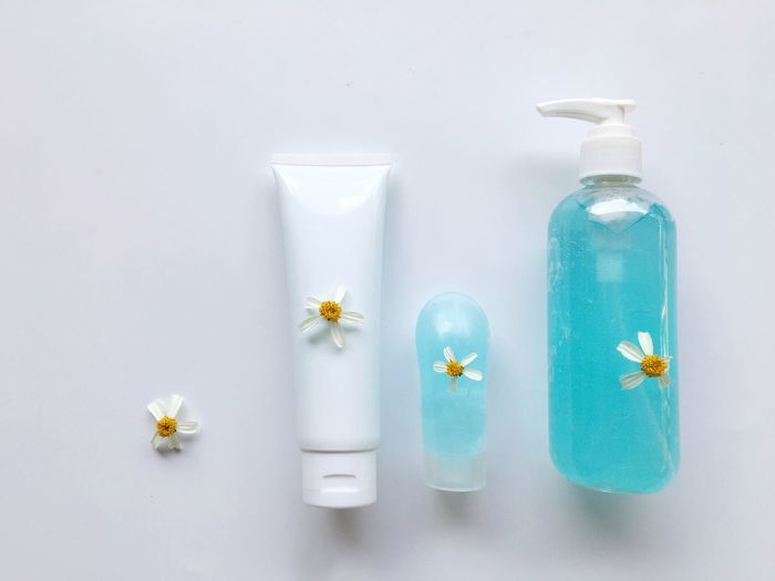 Close-up of white flower in glass bottle