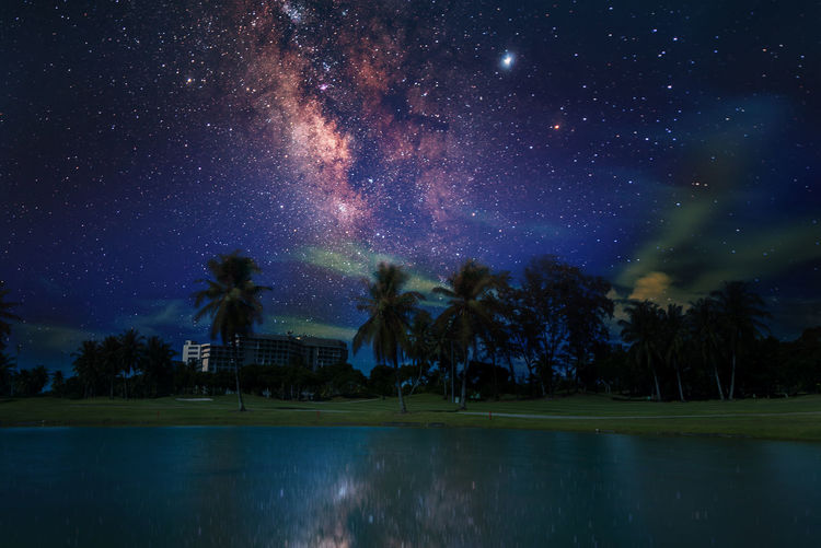 Scenic view of swimming pool against sky at night
