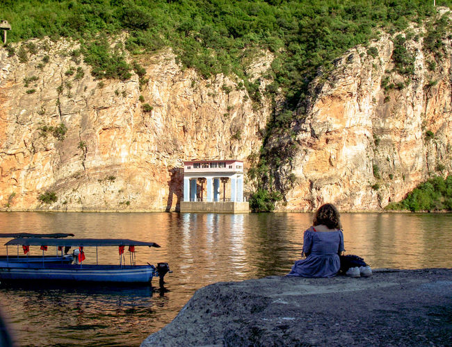 One Woman Only Sitting Outside Sitting Alone Watching The View Thinking About Life Water Tree Lake Architecture Built Structure Boat Rippled Water Vehicle Outrigger Shore Calm Waterfront Rock Formation Nautical Vessel Lakeside Port