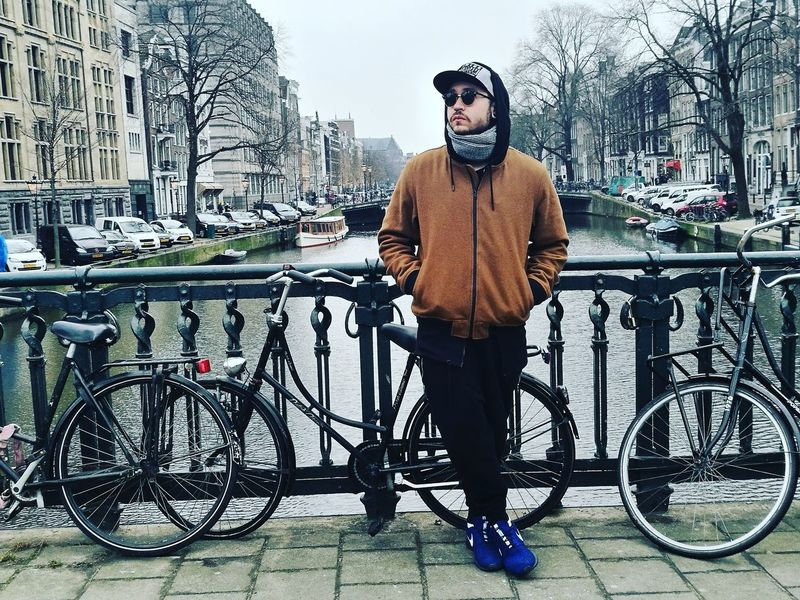 Bicycle Cycling Mode Of Transport Transportation One Man Only Adults Only Only Men Exercising Lifestyles Healthy Lifestyle One Person Riding Outdoors Sport Beard Cycling Helmet Racing Bicycle Water People Men Amsterdam