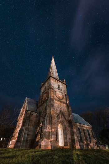 Low angle view of temple against sky at night