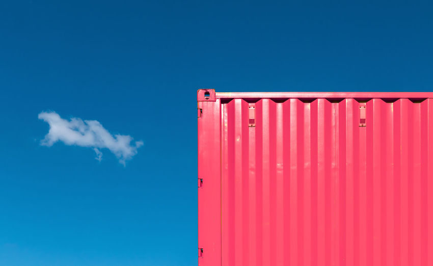 Low angle view of container against blue sky