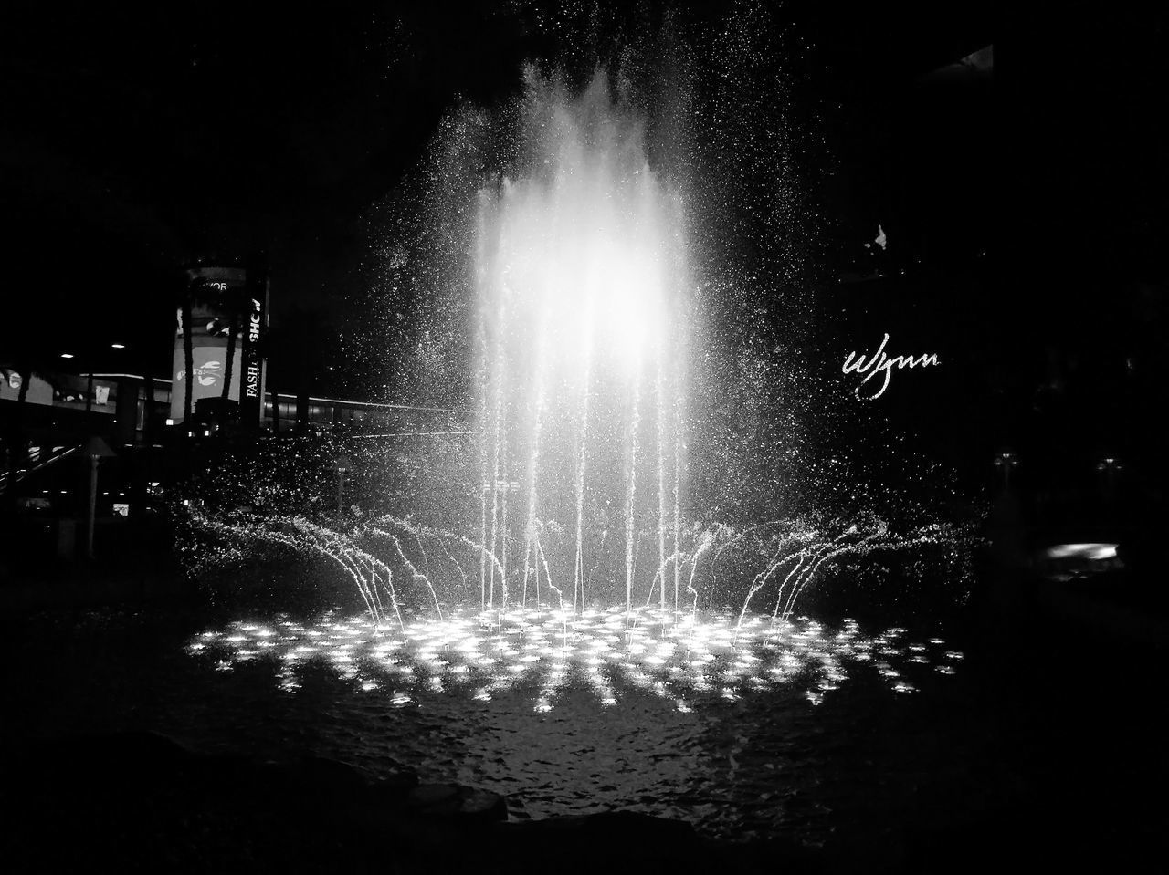night, illuminated, glowing, motion, long exposure, no people, arts culture and entertainment, celebration, architecture, lighting equipment, water, nature, outdoors, built structure, light, firework, city, fountain, street
