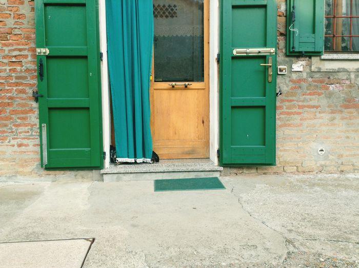 Closed door of house in city