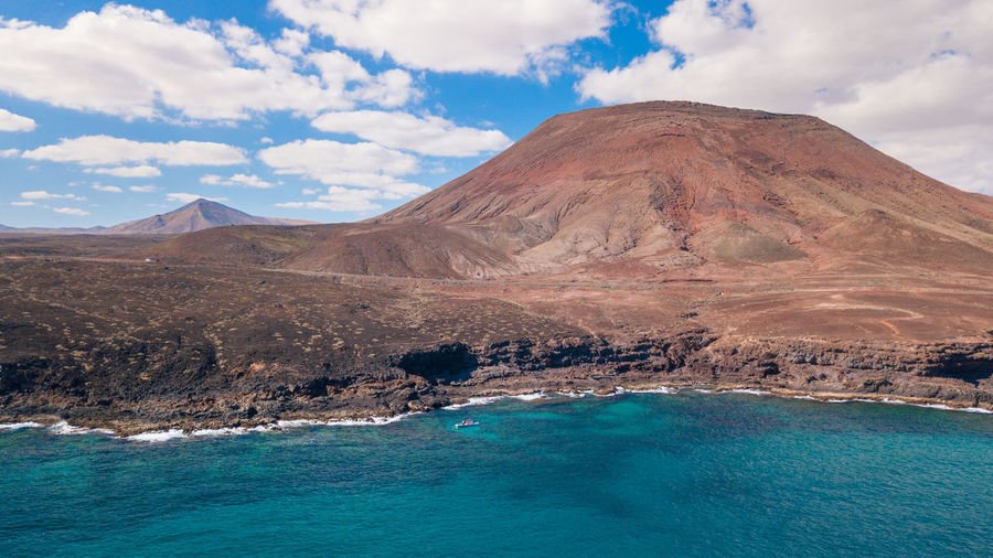 Mountain Scenics - Nature Sky Beauty In Nature Cloud - Sky Tranquil Scene Water Tranquility Non-urban Scene Nature Idyllic No People Land Day Waterfront Sea Landscape Outdoors Remote Turquoise Colored Lagoon Volcanic Crater