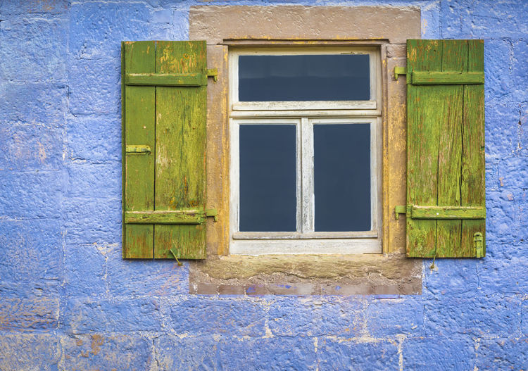 Close-Up Of The Window Of An Old Residential Building