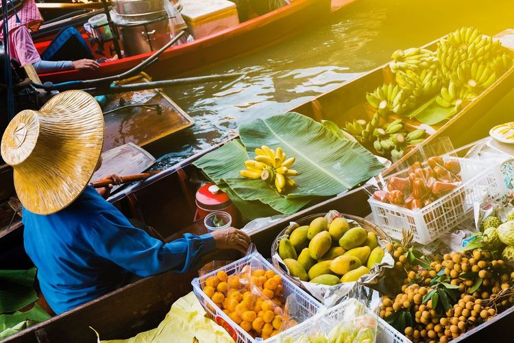 High angle view of man selling fruits in boat on lake