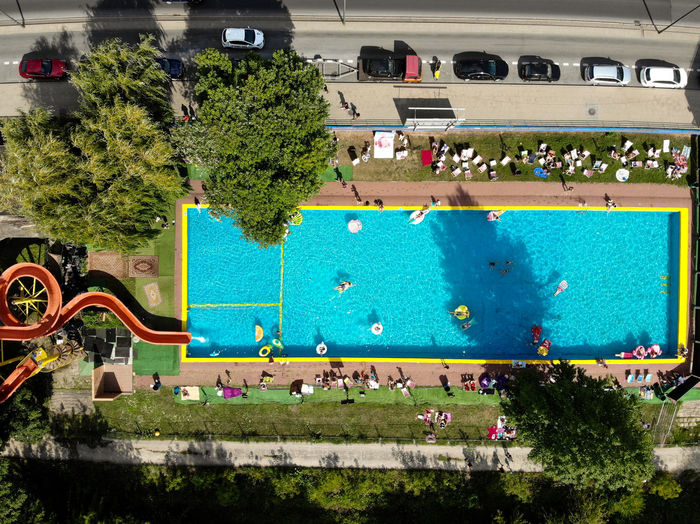 High angle view of people at swimming pool