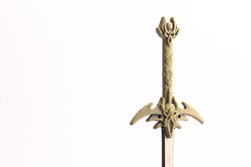 Sword Shaped Letter Opener Close-up Day Demon Letter O Letter Opener Letters Macoron Macro No People Skull Small Swiss Garden Streetphotography Swimming Sword Of Gryffindor White Background