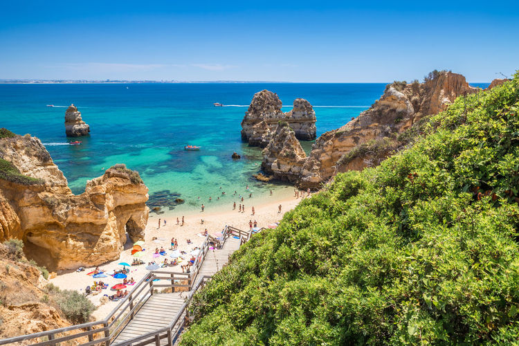Praia do Camilo near Lagos, Portugal Nature Outdoors Portugal Beach Beachphotography Algarve Lagos Portimão, Portugal Praia Do Camilo Rocks And Water Beauty In Nature Cliff Ponta Da Piedade Turquoise Colored Tourism Tourist Destination