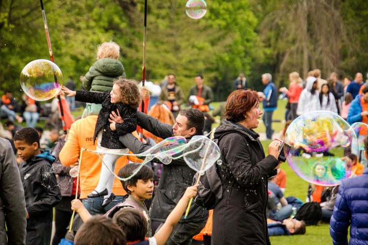 Amsterdam Bubbles Children Kids King's Day 2018 Koningsdag 2018 Festival Group Of People Men Parents Park Vondelpark Women