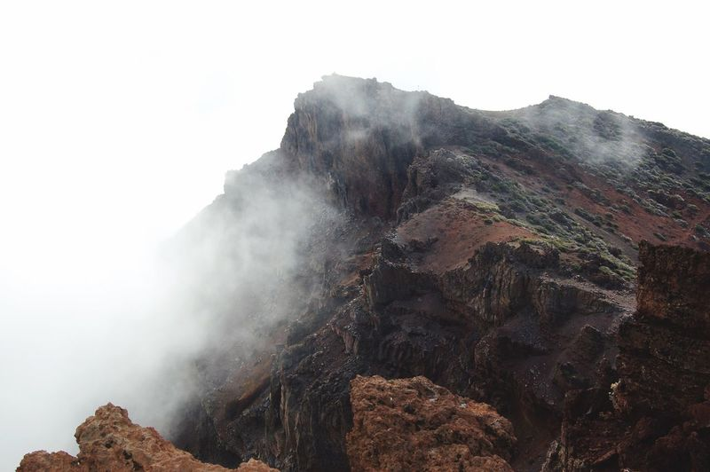 Low Angle View Of Mountain In Foggy Weather