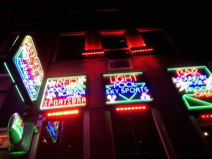 These neon lights, lighting up all around the red light district in Amsterdam Happy EyeEm Best Shots EyeEmNewHere Enjoying Life Photography Light Red Amsterdam Illuminated Text Communication Western Script Night No People Sign Architecture Neon Low Angle View Lighting Equipment Multi Colored Gambling Built Structure Glowing Building Exterior City Information Information Sign EyeEmNewHere A New Perspective On Life Capture Tomorrow Streetwise Photography