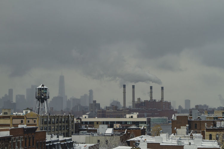Firm Industry NYC Smoke Architecture Building Exterior Built Structure Chimney City City Life Cityscape Day Emitting Factory Industry No People Outdoors Pollution Sky Skyscraper Smoke - Physical Structure Smoke Stack Tall